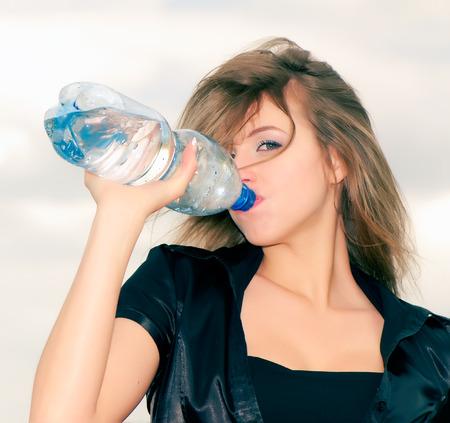 beautiful business woman drinking water, closeup photo