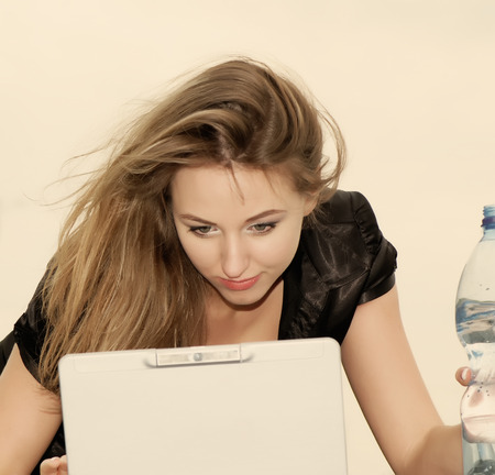 beautiful business woman drinking water maintenance used laptop, closeup photo