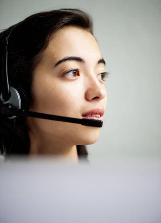 Call center operator businesswoman with laptop computer, closeup photo