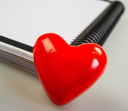 Valentine heart symbol on an office notebook photo