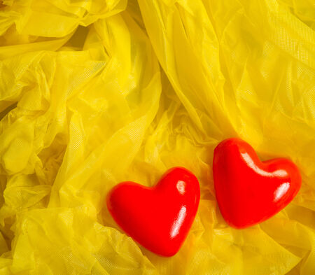 Valentine heart symbols on a yellow background photo