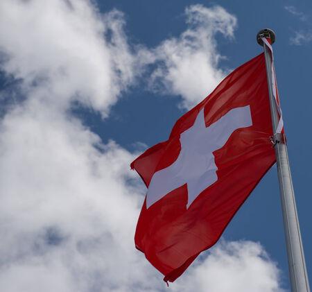 Swiss flag on a  blue sky photo