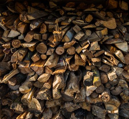 stockpile: stockpiled chopped firewood in the village, the autumn season