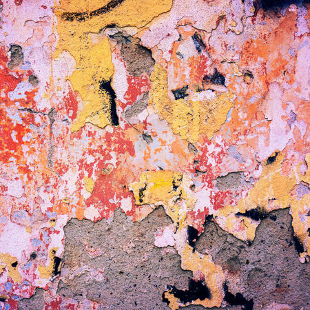 crumbling: crumbling surface of old plaster painted on a concrete wall