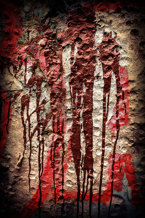 spilled red and brown paint on the wall photo