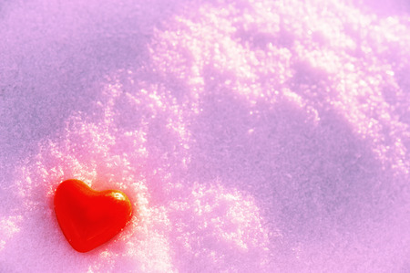 symbol of valentine heart in the snow photo