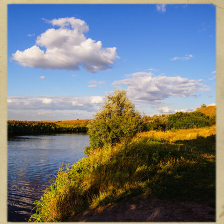 rural landscape, steppe river and clouds on the sky background photo