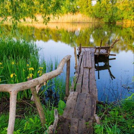 rural landscape, the river and the old wooden bridge, spring season photo