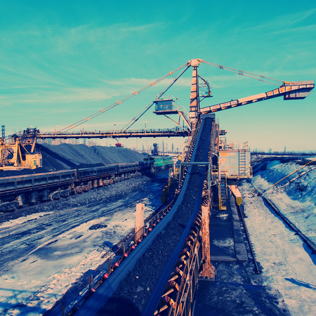 open trench: conveyor transport for loading iron ore from the warehouse