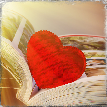 valentine heart lies in the book close-up photo