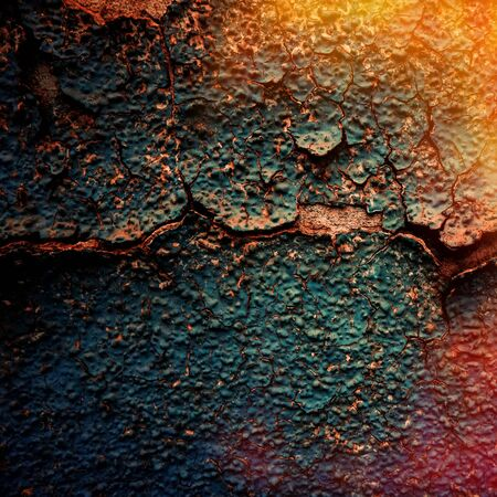 crumbling: crumbling surface of old painted plaster walls