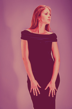 portrait of a pretty young blonde woman in evening dress in the studio photo