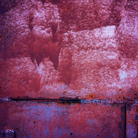 rust covered: surface of the metal sheet covered with old paint and rust Stock Photo