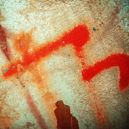 surface of the metal sheet covered with old paint and rust photo