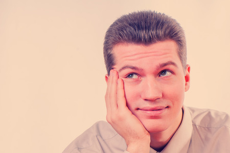 business skeptical: portrait of handsome businessman looking skeptical towards on a light background Stock Photo