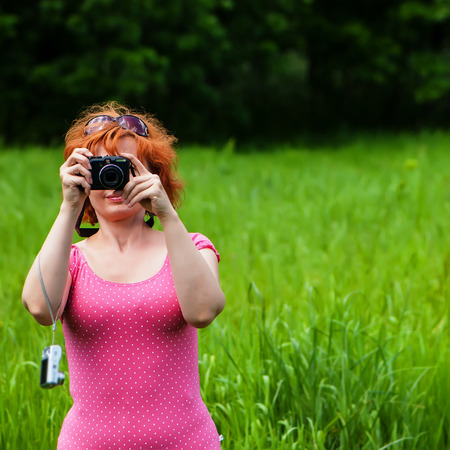 exists: women exists amateur photographer taking pictures in the park