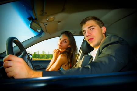 portrait of a pair of businessmen and women in the car photo