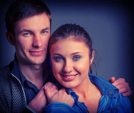 cute young couple man and woman portrait in studio photo