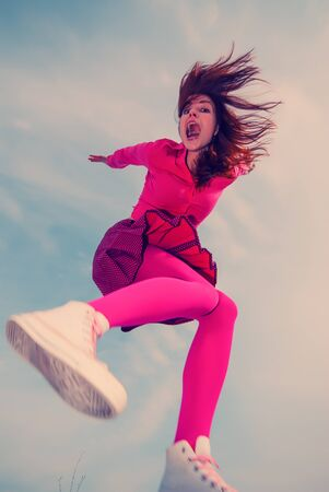 girl jumped on the sky background photo