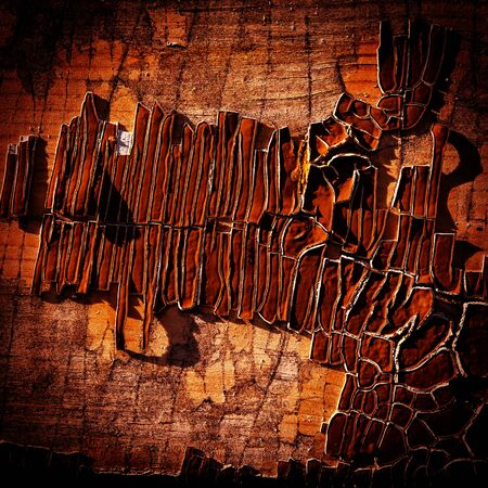 old wooden surface covered with crumbling paint photo