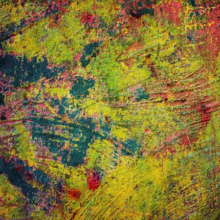 flaking: paint on old crumbling plaster walls