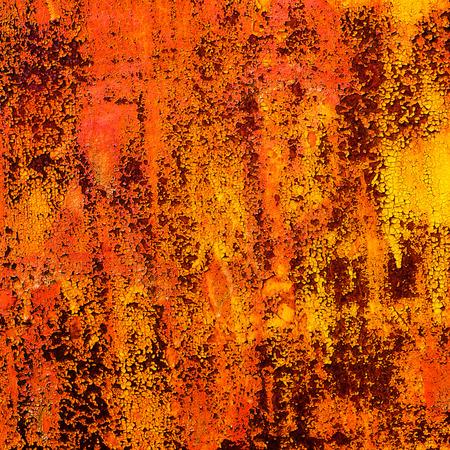 disintegrating: disintegrating old paint surface on the metal sheet