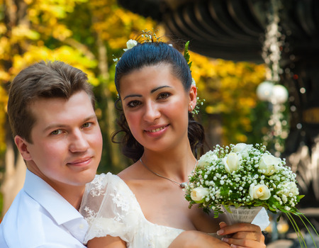 newly married couple: portrait of a newly married couple in the park. summer season Stock Photo