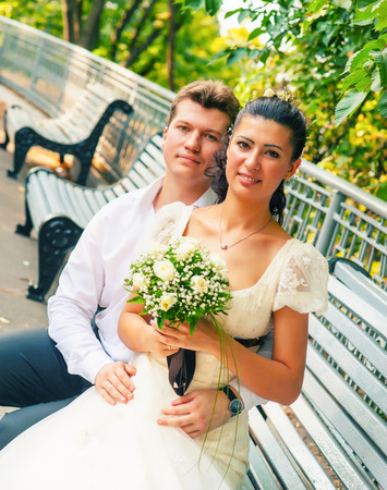a newly married couple: portrait of a newly married couple in the park. summer season Stock Photo