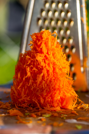 metal grater: old shredder residues with carrots summer in the village