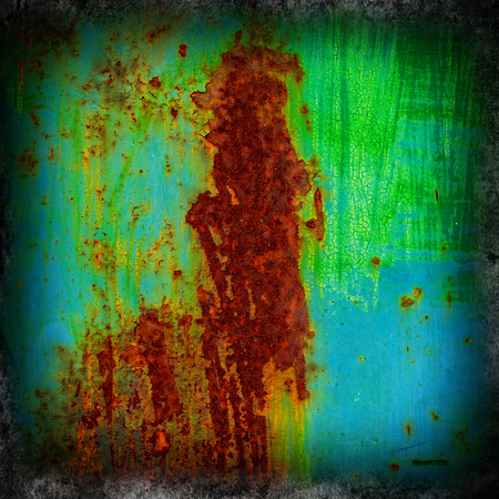 crumbling: background, surface crumbling old rusty metal sheet coated with paint Stock Photo