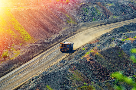 tipper and road for trucks in a pit of iron ore
