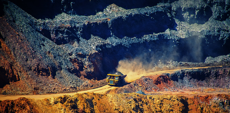 delivers: Truck delivers the raw material in a career of iron ore