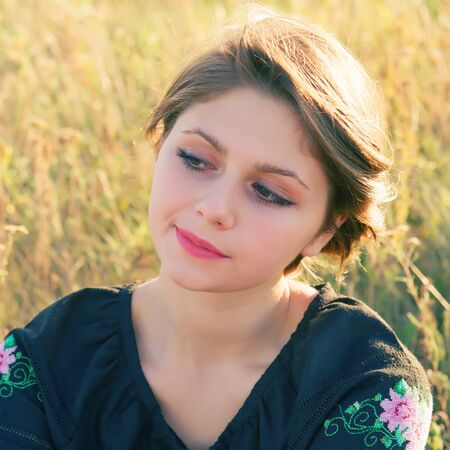 lost in thought: portrait of a teenage girl lost in thought outdoors Stock Photo