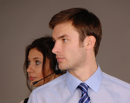 young business couple looking towards a dark background photo
