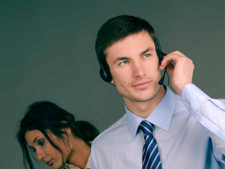 business couple negotiate on the speakerphone on a dark background photo