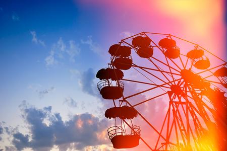 Ferris wheel on the background of night sky