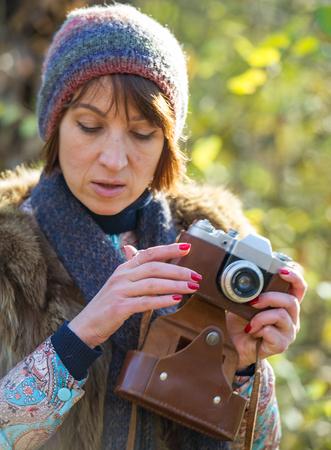 analog camera: woman photographs the analog camera, the age of 40 years Stock Photo