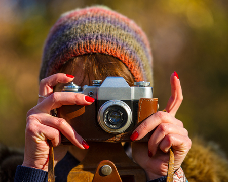 copyspace: woman photographs the analog camera, the age of 40 years Stock Photo
