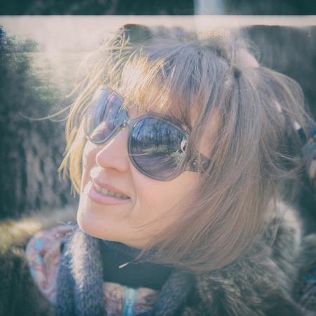 40: portrait of a pretty woman in sunglasses, age 40 years