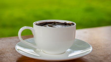 woden: cup of coffee on the woden background Stock Photo