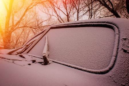 abandoned car: windshield of the old abandoned car covered with snow Stock Photo