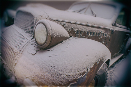 abandoned car: Old abandoned rusty car covered with snow