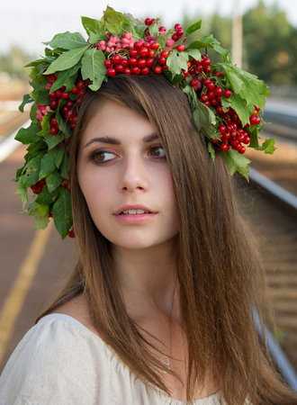 portrait of a girl with a wreath on his head viburnum