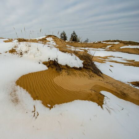 melting snow and sand dunes, the spring thaw
