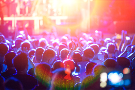 street musician: Scene and light, a crowd of fans during a rock band concert