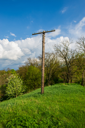 rural landscape old wooden post and blue sky Stock Photo