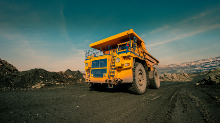 Transportation by dump trucks of iron ore from the pit