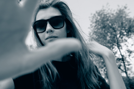 interdiction: young woman in sunglasses forbids Stock Photo