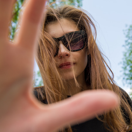 young woman in sunglasses forbids Stock Photo