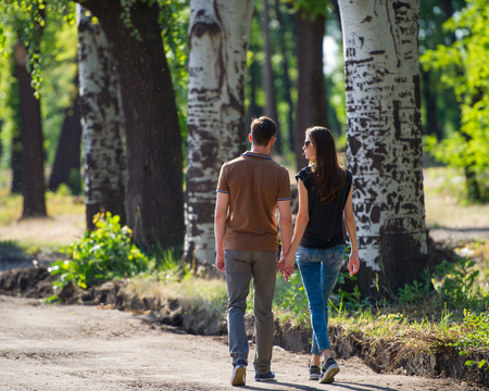 Lovers for a walk in the park sunny day Stock Photo
